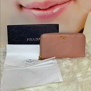 Prada pink zippy long wallet with box.